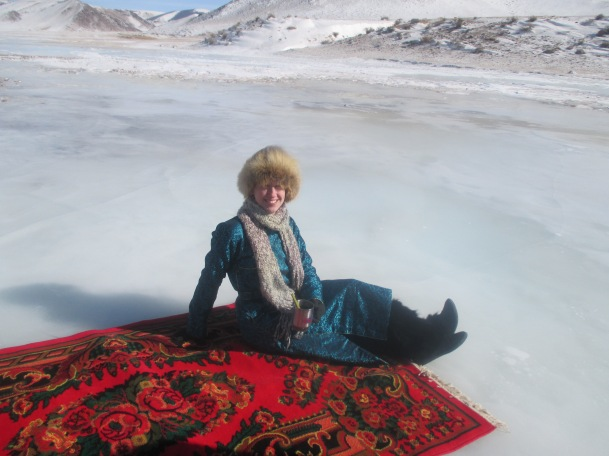 Drinking coffee on a carpet on a frozen river