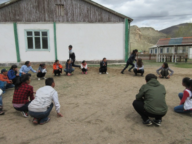 Playing a game similar to duck duck goose during Friendship time